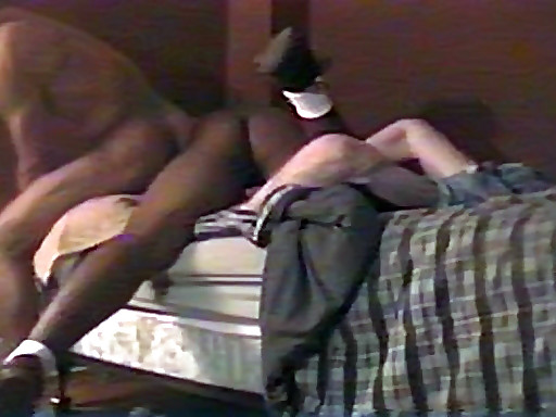 A submissive white guy is tied to the bed and promptly railed by two black men. The other guy..